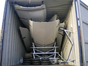 Musto Skiffs packed in container for shipping to SA